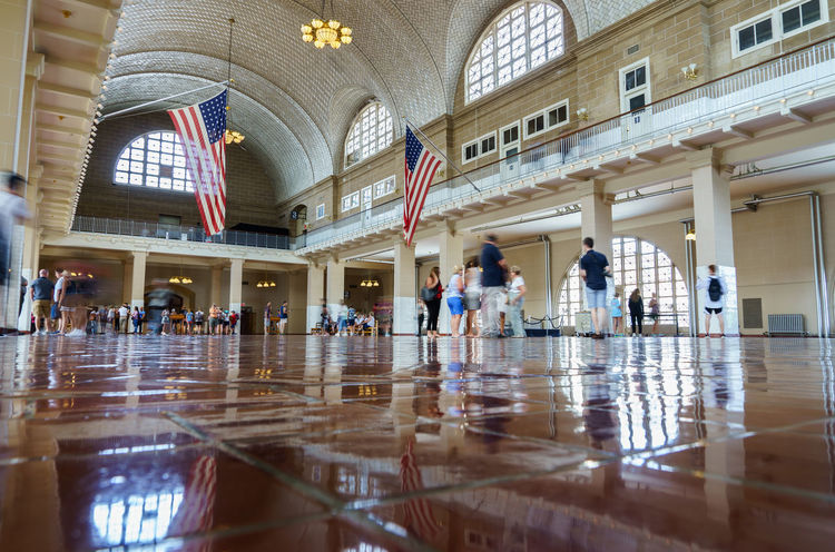 Ellis Island  Immigration New Jersey New York New York City Sightseeing Statue Of Liberty USA America Architecture Day Famous Place Group Of People History Indoors  International Landmark Medium Group Of People Men People Real People Reflection Registration Registration Hall Women
