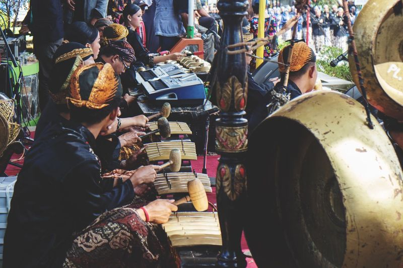 Rear view of people in traditional clothing