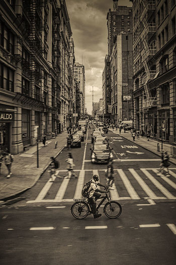 Bicycle on road against buildings in city