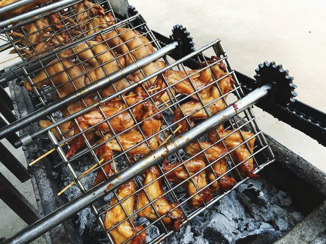 grilled chicken Chickens Grilled Chicken Metal High Angle View No People Barbecue Food Preparation  Barbecue Grill Heat - Temperature Fire Preparing Food Grid Flame Metal Grate Grate Nature Fire - Natural Phenomenon Food And Drink Burning Freshness Grilled