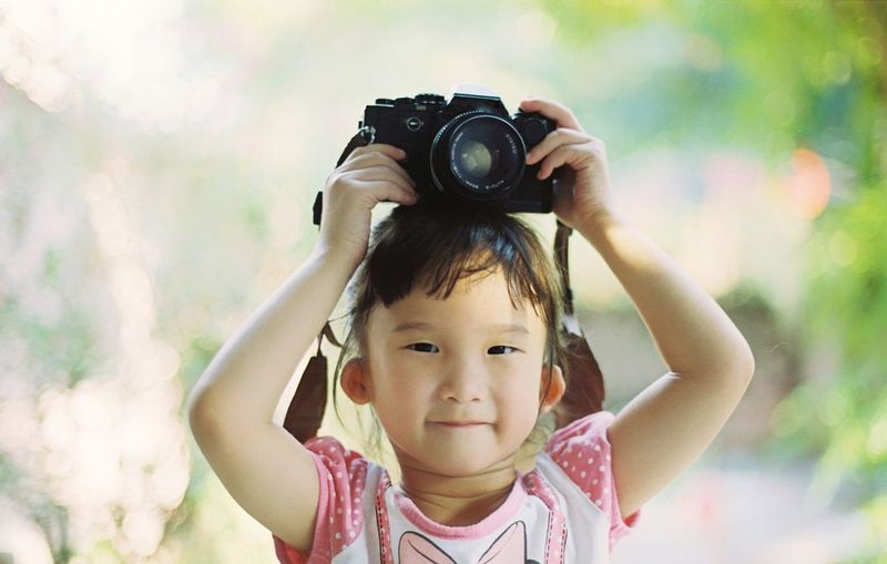 Little girl holding a camera Little Girl Camera Kids Childhood Child Portrait Offspring Girls One Person Front View Looking At Camera Camera - Photographic Equipment Women Photography Themes Headshot Females Casual Clothing Technology Photographing Real People Human Body Part Close-up Innocence