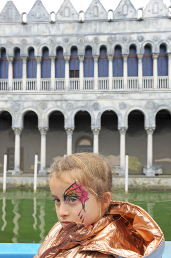 Portrait of girl in front of building