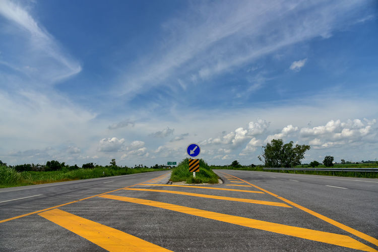 Zebra crossing on road against sky
