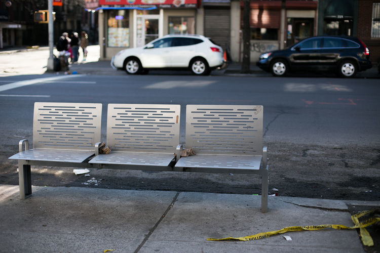 Empty metallic bench on street