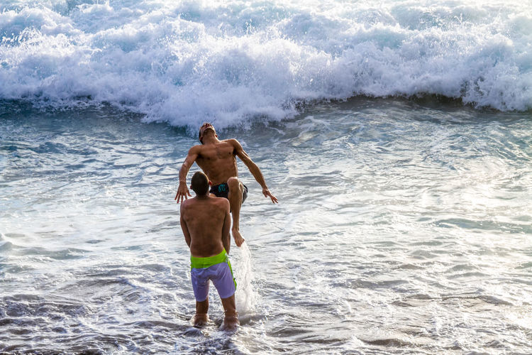 leisure activity at the beach in Reunion Island Adult Adventure Beach Children Only Day Etang Salé EyeEm RéunionIsland Full Length Nature One Person Outdoors People Sand Sea Shirtless Snorkeling Summer Vacations Water Wave The Street Photographer - 2017 EyeEm Awards Done That.