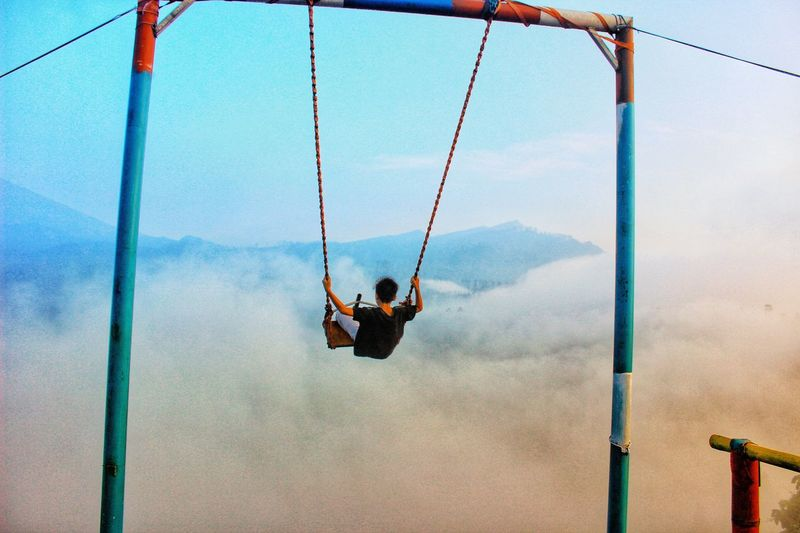 Low angle view of swing at playground