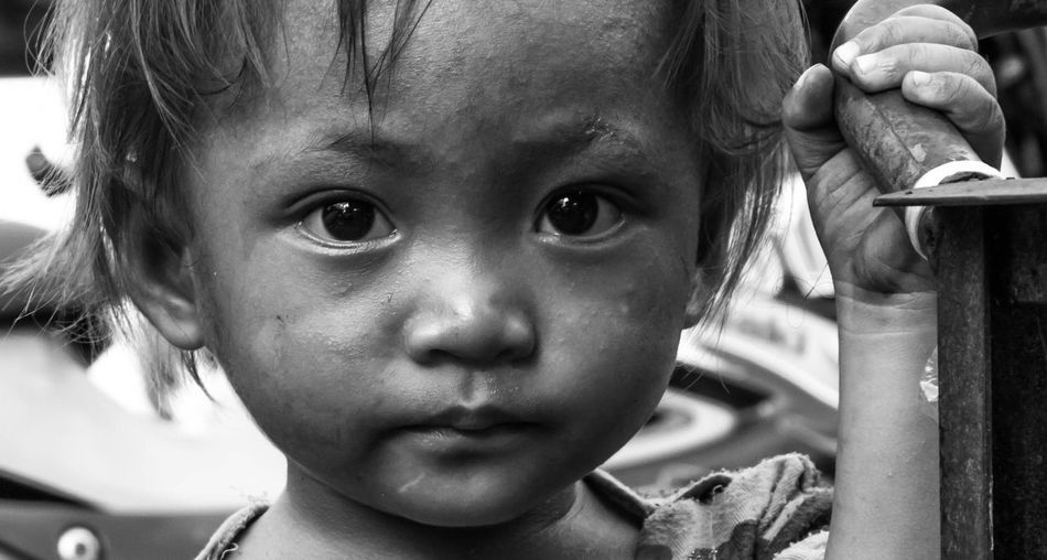 Children of Manila, A Child at Baclaran Market, Philippines. September 20, 2016. Photo by Olga Mihova #candid #documentary #photojournalism #streetphoto_bw #streetphotography #travel #travelphotography Everydayphilippines First Eyeem Photo