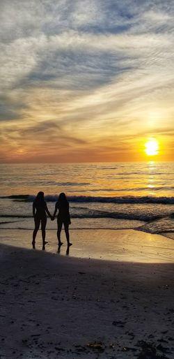 Water Sea Sunset Full Length Beach Togetherness Sand Silhouette Sun Sunlight Shore Romantic Sky Sandy Beach Seascape Horizon Over Water