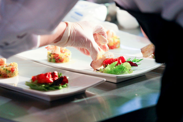 Business Chef Food Food And Drink Freshness Hand Healthy Eating Human Body Part Human Hand Indoors  One Person Plate Preparation  Preparing Food Ready-to-eat Real People Restaurant Selective Focus Serving Size Table Unrecognizable Person Wellbeing