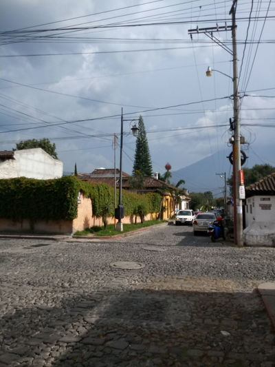 Cable Electricity  Electricity Pylon Transportation Power Line  Connection Car Fuel And Power Generation Cloud - Sky Day Outdoors Sky Road No People Technology Tree Parallel Travel Destinations La Antigua Guatemala Guatemala 🇬🇹 Volcano Old Architecture Travel Colony Old Buildings