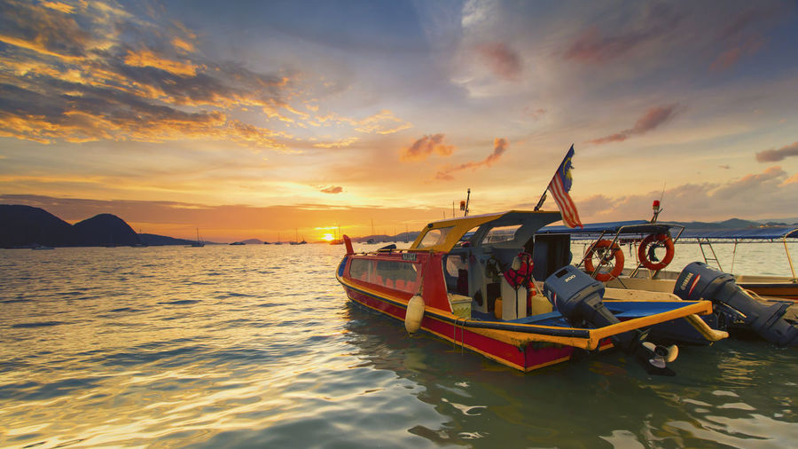 Water Sunset Nautical Vessel Sky Transportation Mode Of Transportation Cloud - Sky Sea Beauty In Nature Scenics - Nature Waterfront Nature Orange Color No People Idyllic Tranquility Tranquil Scene Travel Moored