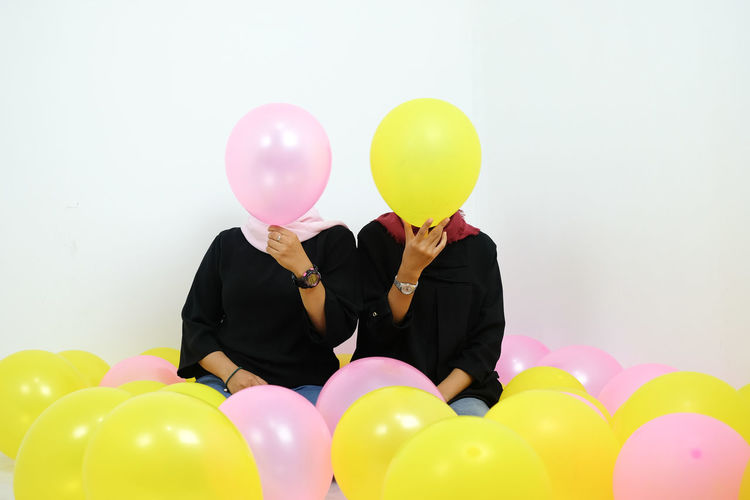 White Background Balloons Bridegroom Young Women Helium Balloon Well-dressed Balloon Togetherness Bonding Women Multi Colored