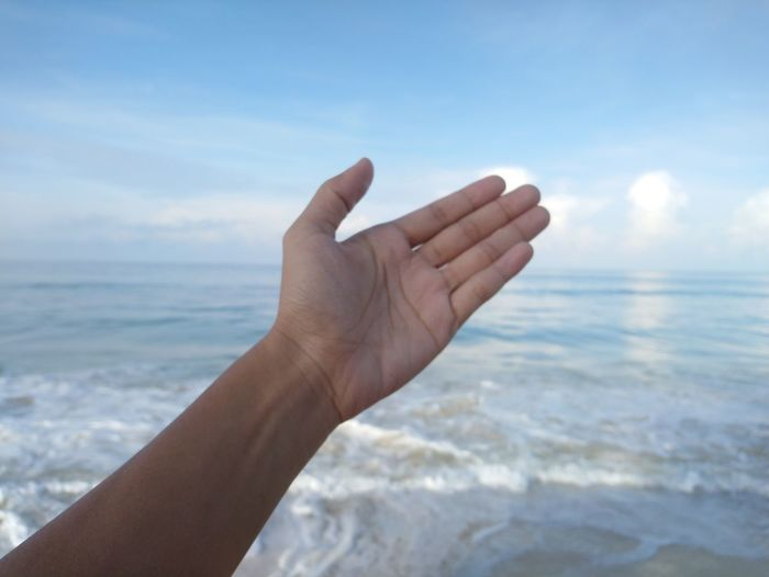 Palm and sea Human Hand Water Sea Beach Business Finance And Industry Body Part The Human Body Hand Close-up Sky Manicure Pedicure Horizon Over Water Fingernail Wave Seascape Beautician Painting Fingernails Human Finger Nail File