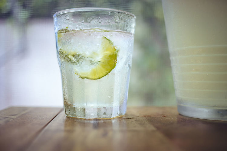 Close-up of lemon soda in glass on table