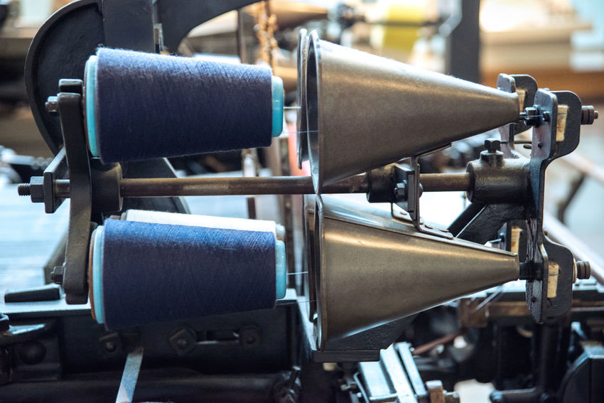 At the Toyota Museum in Nagoya, Japan Blue Close-up Equipment Fabric Focus On Foreground In A Row Loom Machinery Manufacturing Part Of Repetition Selective Focus Sewing Spool Spool Of Thread Tailored To You Textile Textile Industry Textile Machinery Thread Weaving Loom Weaving Machine Ultimate Japan