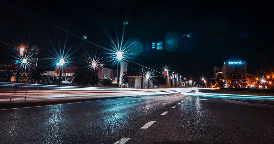 Night Illuminated Long Exposure Light Trail Street Road Street Light City Transportation Motion Building Exterior Architecture Built Structure Outdoors No People Sky