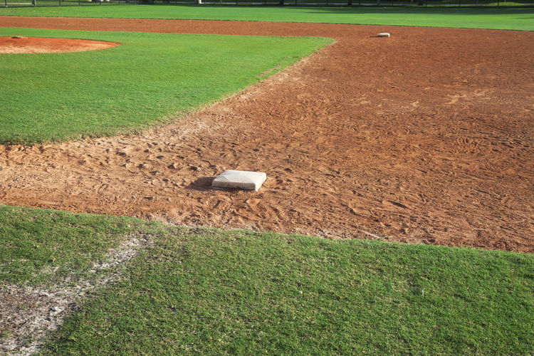 Baseball infield from first base side Baseball Field Dirt Grass Green Color Sport Sunlight Youth Outdoors No People Photography Infield First Baby Base Path Selective Focus Second Base