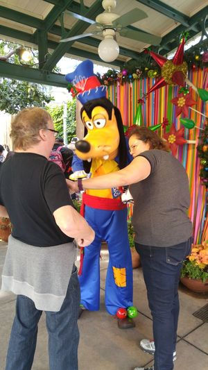Goofy and I trying to figure out if goofy's name is on Jim's shirt. Viva Navidad