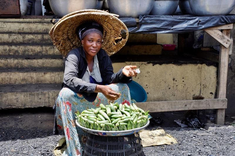 Portrait Of Vendor Selling Vegetables At Market