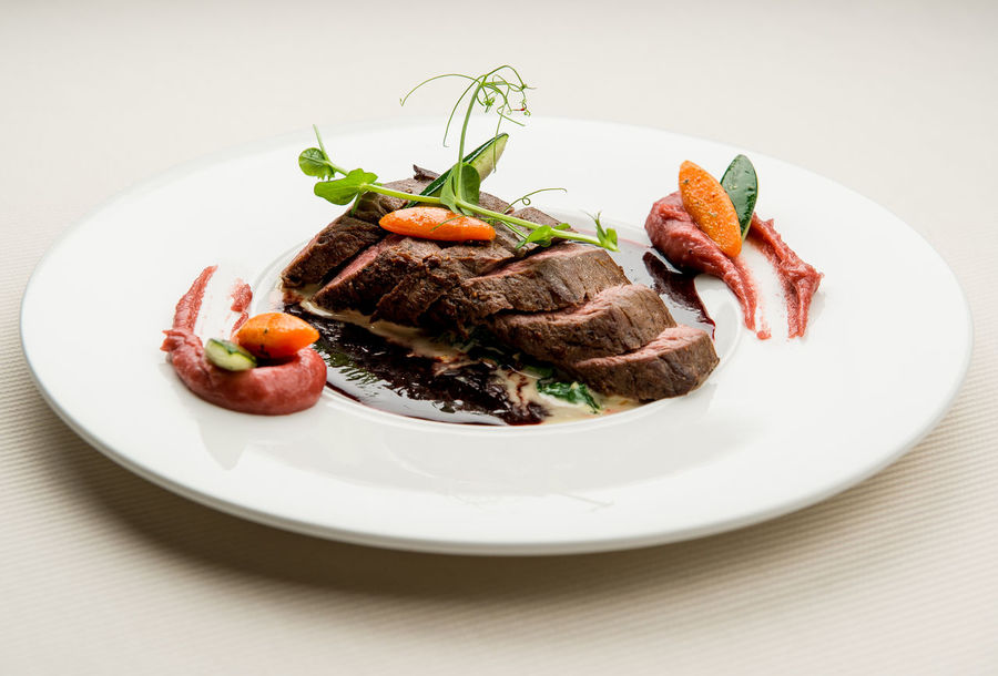 Roe deer fillet with vegetables, purple potato puree and red wine sauce Cuisine Dinner Dinning Dish Meal Time Table Setting Appetizing  Close-up Delicacy Delicious Fillet Food Gourmet Main Course Meat No People Nobody Plate Restaurant Restaurant Food Roe Deer Sauce Serving Dish Tasteful Tasty