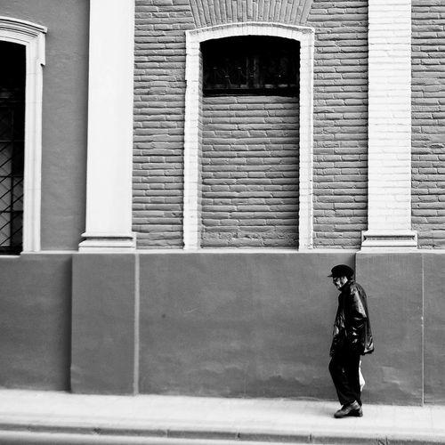 Full length of man standing against window