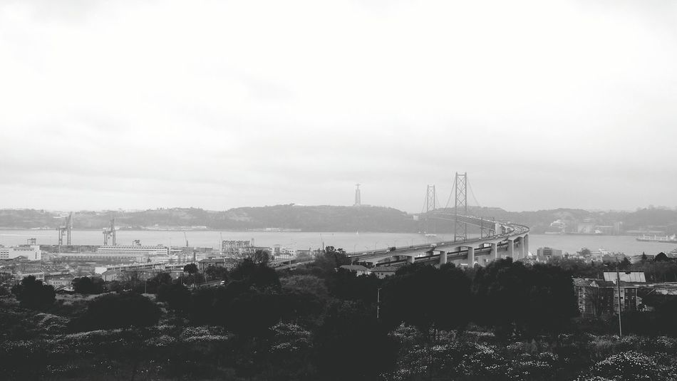 Showcase April The City Landscape the Bridge View Black And White Photography Rainy Day Lisbonlovers Lisbon City Explorer Bridge25April Bridge - Man Made Structure Taking Photos Lisboa Portugal Cityscapes Outdoors