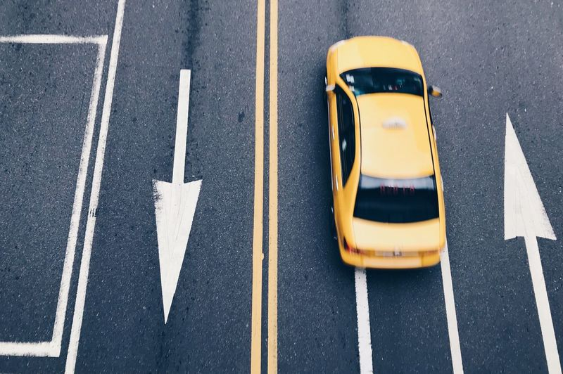 High Angle View Of Yellow Taxi On Road