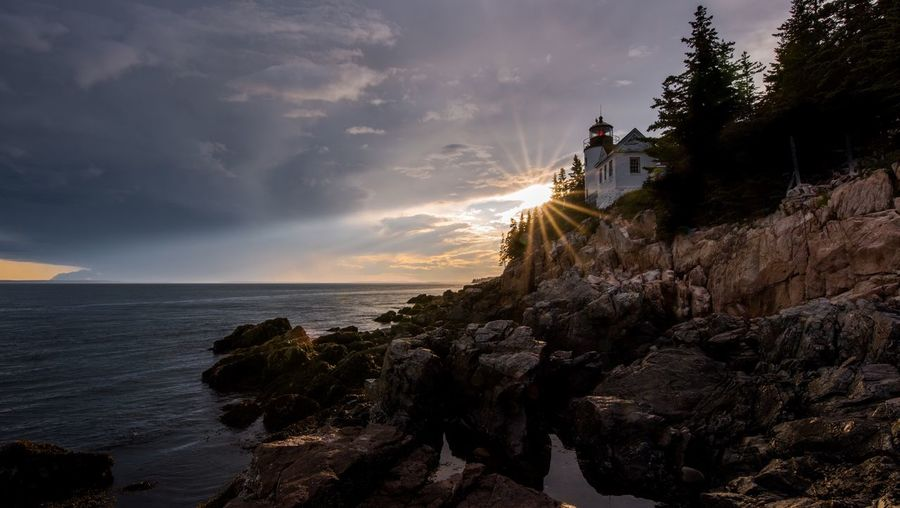 Bass Harbor Light at Sunset Sunset Maine Light Bass Harbor Bass Harbor Lighthouse Sea One Man Only One Person People Adult Only Men Adults Only Sky Outdoors Vacations Nature Water Beauty In Nature