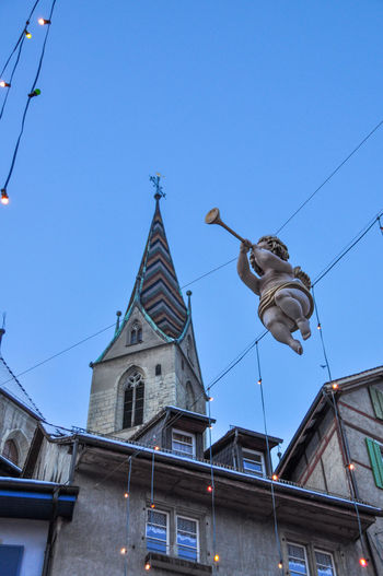 Advent Angel Architecture Baden Blue Christmas Church Clear Sky Clock Tower Decoration Exterior Lamps Lights Low Angle View Outdoors Religion Switzerland Here Belongs To Me Trumpet Roof The Culture Of The Holidays