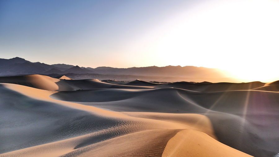 Tranquil Scene Tranquility Scenics - Nature Beauty In Nature Sky Environment Sunset Landscape Non-urban Scene Sand Dune Mountain Nature Desert Idyllic Remote Sunlight Arid Climate Sand No People Land Climate Lens Flare