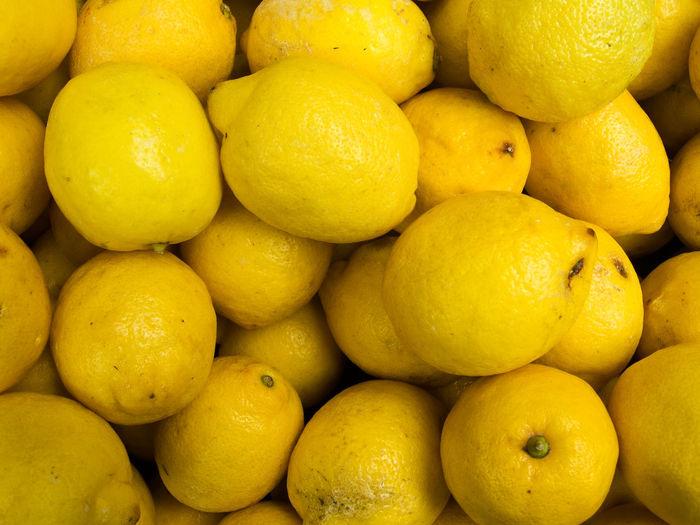 Full frame shot of lemons for sale at market
