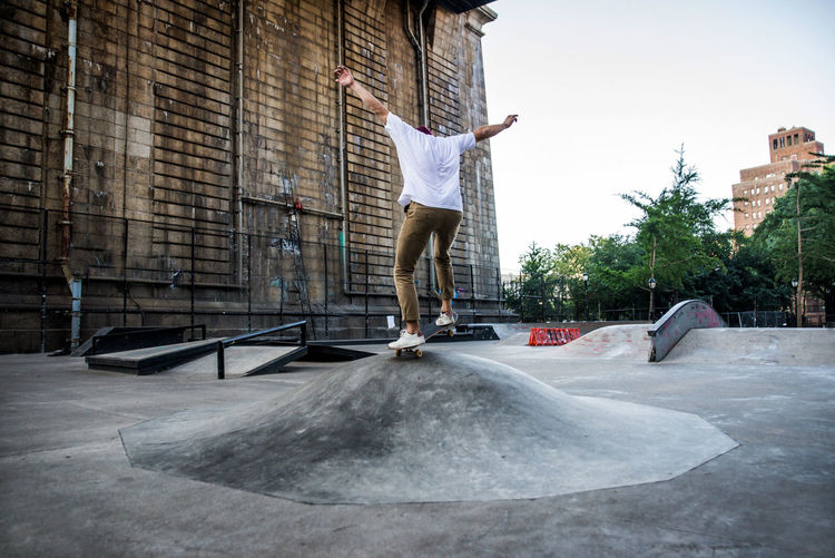 Man skateboarding on street in city