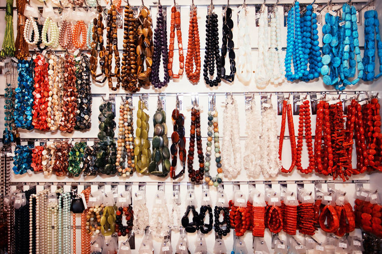 Various neckless hanging on rack for sale