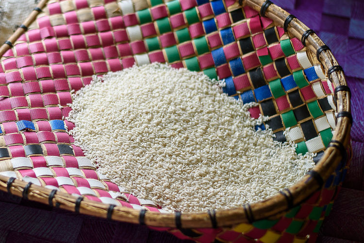 human processed mountain or hillside rice at a Miri long house Rice Rice Grain Art And Craft Close-up Container Food And Drink Grain High Angle View Indoors  Mountain Rice Multi Colored No People Pattern Still Life Weave Basket