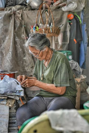 Senior Woman Working At Market Stall