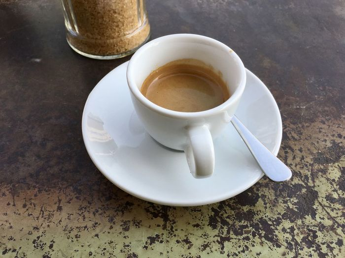 Espresso Coffee Coffee - Drink Coffee Cup Crockery Cup Drink Eating Utensil Food Food And Drink Freshness High Angle View Indoors  Kitchen Utensil Mug No People Non-alcoholic Beverage Refreshment Saucer Spoon Still Life Table Tea Cup Temptation