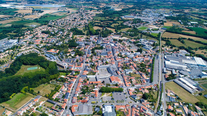Aerial photography of Machecoul city center in Loire Atlantique, France Aerial Photography Aerial View Agriculture Church City City Center Cityscape Countryside Drone Shot France French Houses Landscape Loire Atlantique Machecoul Railway Station Residential Building Rural Scene Sky And Clouds Town Village Ville De Machecoul