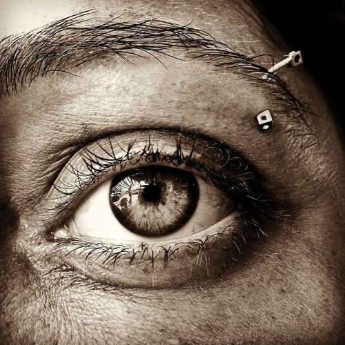 Close up portrait of woman with pierced eyebrow