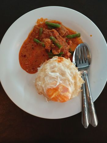 Thai food-Rice and Fried stir with red curry paste Chilli Cook  Pork Curry Rice Paddy Eat Delicious Sauce Meat Plate Egg Egg Yolk Food And Drink Food Ready-to-eat Plate No People Serving Size Freshness Indoors  Close-up Healthy Eating Day
