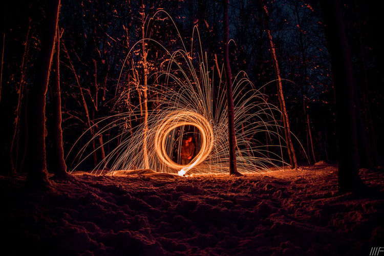 Night Long Exposure Motion Illuminated Wire Wool Land Glowing Blurred Motion Burning Fire Spinning Nature Fire - Natural Phenomenon Light Painting Outdoors Field Orange Color Sign Tree Light - Natural Phenomenon No People Sparks Light