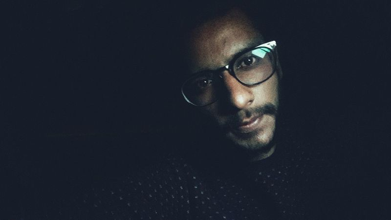 love EyeEm Selects Love Yourself Eyeglasses  One Man Only Only Men One Person Adults Only Human Body Part Adult Human Face Looking At Camera Human Eye Mid Adult Portrait Close-up Concentration Headshot Indoors  Mature Adult Black Background People Horn Rimmed Glasses