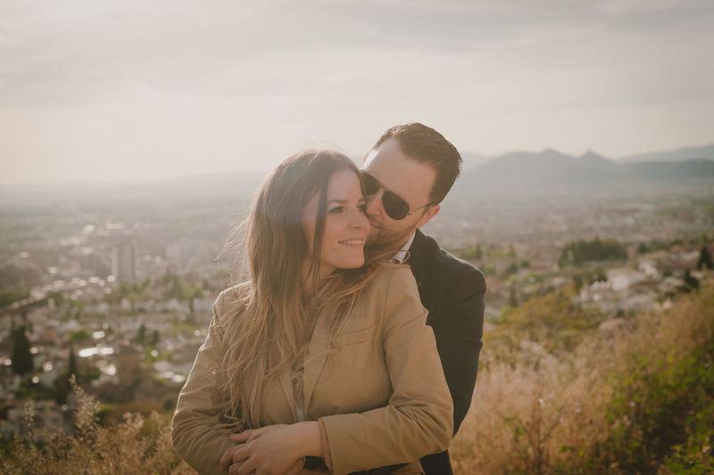 Man embracing woman