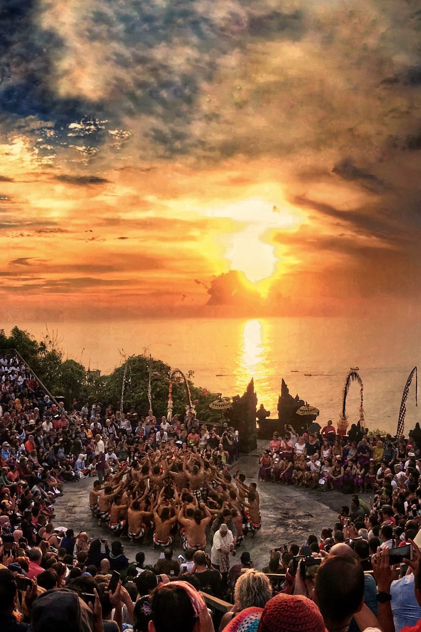 crowd, sunset, sky, group of people, large group of people, real people, cloud - sky, water, nature, women, sea, beauty in nature, lifestyles, men, orange color, leisure activity, sun, adult, outdoors, horizon over water, festival