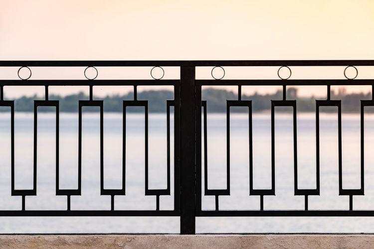 Close-up of railing against window