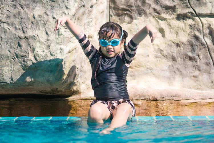Full length of boy in swimming pool