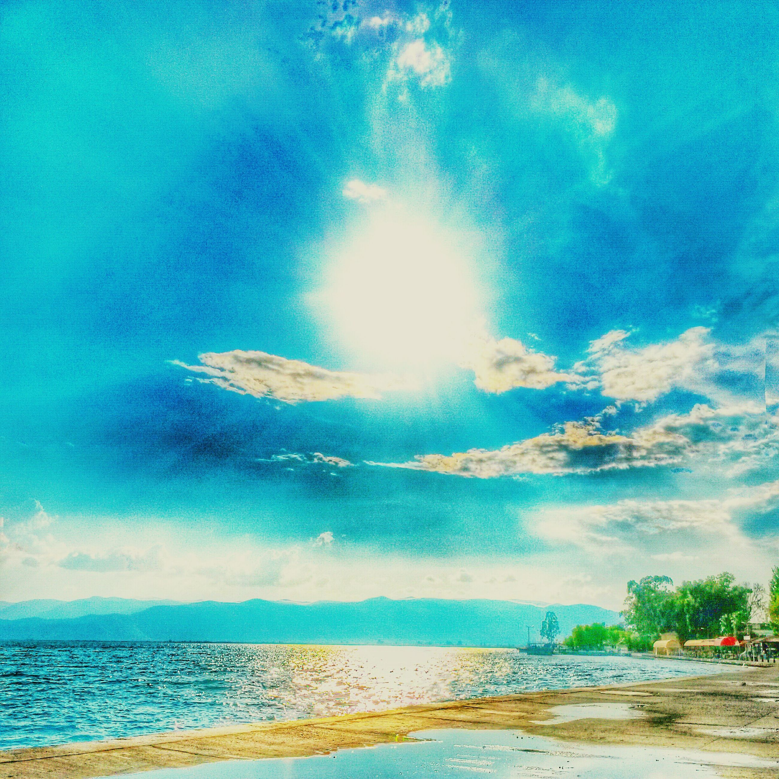 water, sea, sky, blue, scenics, beauty in nature, tranquil scene, tranquility, nature, horizon over water, cloud - sky, beach, sunlight, sunbeam, idyllic, cloud, waterfront, sun, shore, day