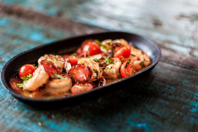 Close-up of shrimp tomato tapas dish