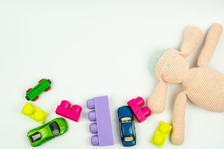 top view of toys ( cars , blocks and puppet ), can be used as a background Copy Space White Background Indoors  Group Of Objects Studio Shot Multi Colored Toy Still Life Close-up Plastic Medium Group Of Objects Variation Toy Car Toys Stuffed Toy Concept Toy Background Toys Isolated Top View Blue Green Purple Pink
