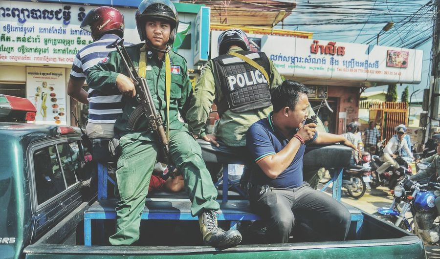 - Cambodian police leaving a street dispute - Travel Photography Cambodia Portfolio Nikon Photolife Cameraready Travellife Adventure Explore