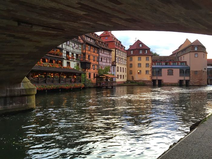 Buildings by river in city